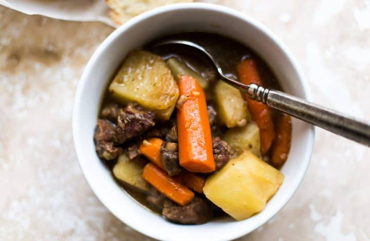 bowl of guinness beef stew with spoon