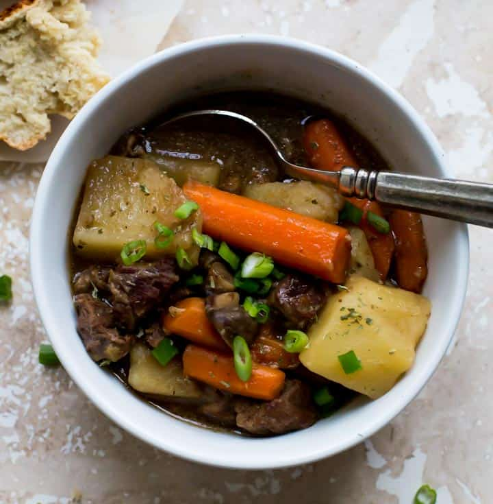 guinness beef stew in white bowl