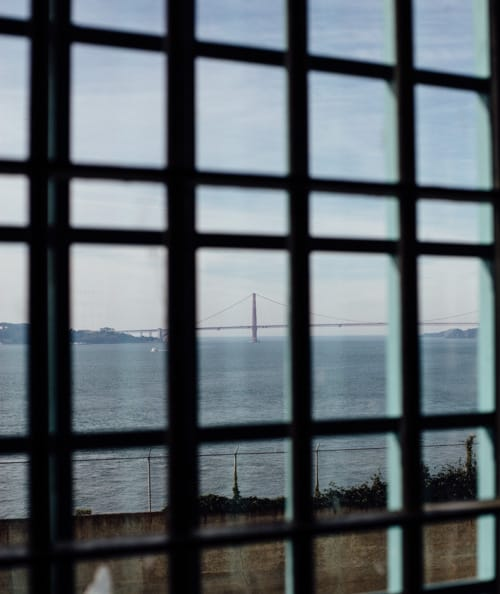 golden gate bridge through mess hall window alcatraz