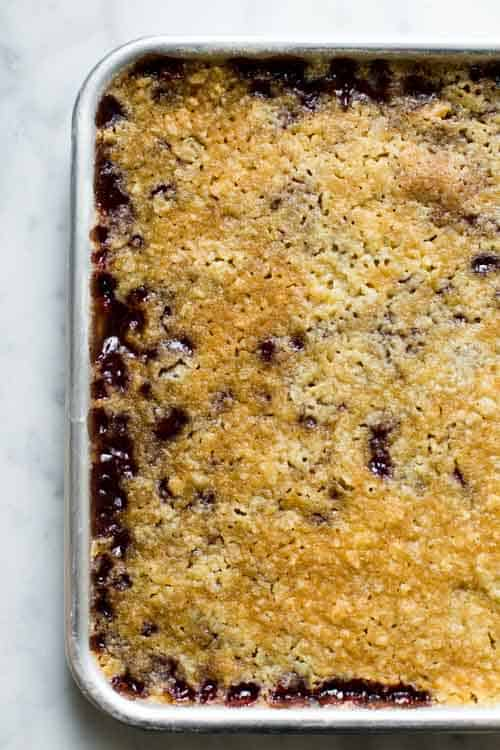 raspberry bars right out of the oven, uncut in baking pan