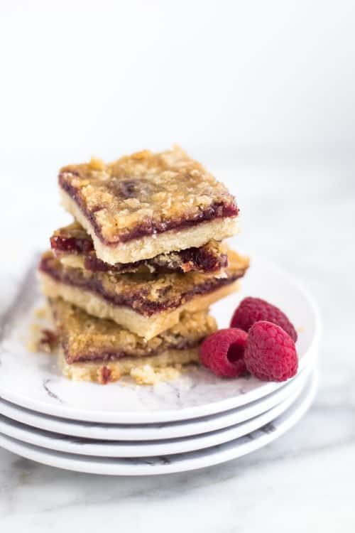 raspberry crisp bars stacked on white plates