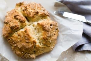 easy irish soda bread loaf on parchment paper
