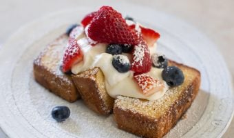 easy red white and blue skillet pound cake dessert on a white plate