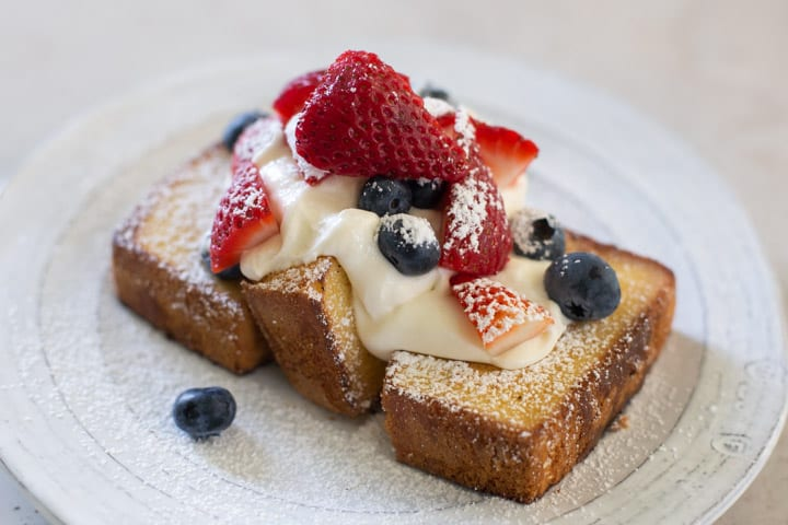 red white and blue skillet pound cake dessert on a white plate