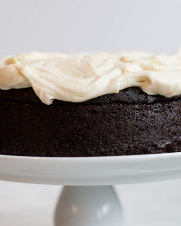 guinness beer dark chocolate cake on a white cake stand