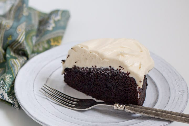 slice of guinness beer dark chocolate cake on a white plate