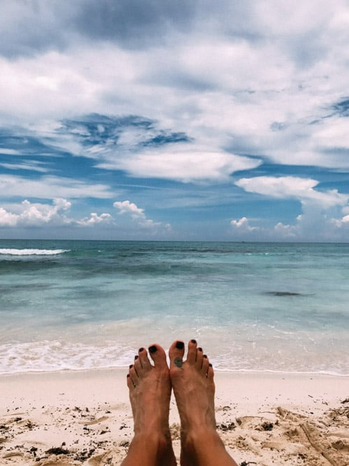 toes with beach and caribbean ocean in background riviera maya mexico unico 2087