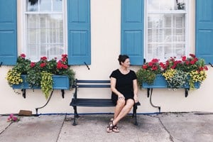 Nikole sitting on a bench in Charleston SC