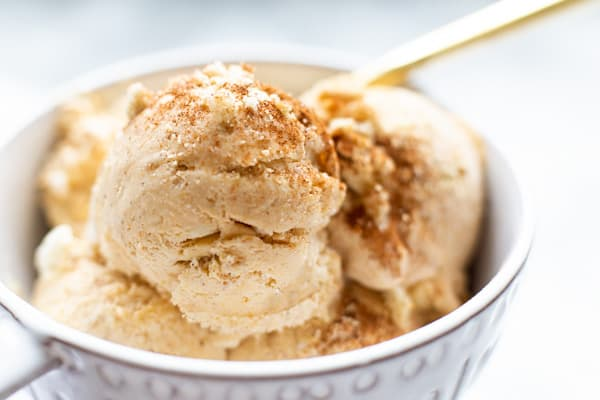 Looking to combine the best of summer and fall? Why not try this easy, no churn Pumpkin Ice Cream! It's creamy and delicious with just the right amount of pumpkin, and it's bursting with pieces of golden sandwich cookies, white chocolate chips, and marshmallows. Perfect dessert anytime you're craving a little taste of fall!