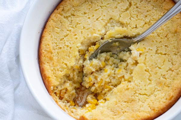 This creamy Corn Casserole is the perfect side dish to accompany your favorite holiday meals. Made with creamed corn, sour cream, and sweet cornbread mix, this recipe is sure to please and is a breeze to make! Only 7 ingredients!