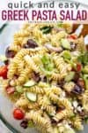 bowl of greek pasta salad with text overlay