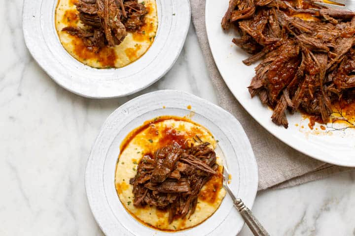 plate of grits with brisket