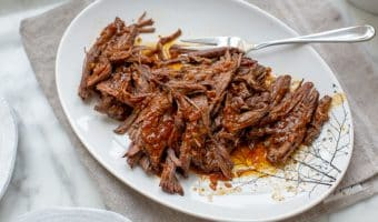 instant pot brisket shredded on a plate