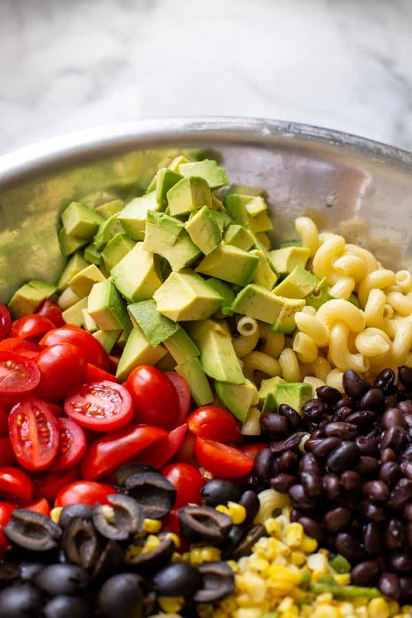 Ingredients in a bowl for Mexican Pasta Salad