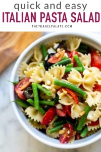 Italian pasta salad in a bowl with text overlay