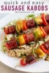 sausage skewers on a platter with rice