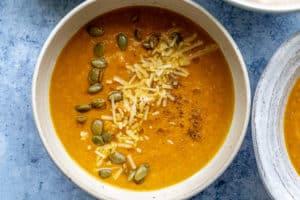 close up of a bowl of pumpkin apple soup