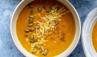 close up of a bowl of pumpkin apple soup