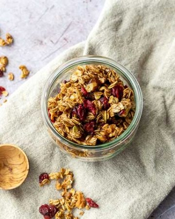 granola in a glass bowl on a linen napkin