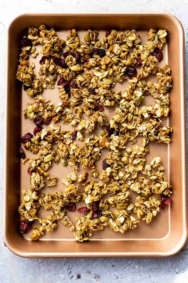 homemade granola recipe cooling on a cookie sheet