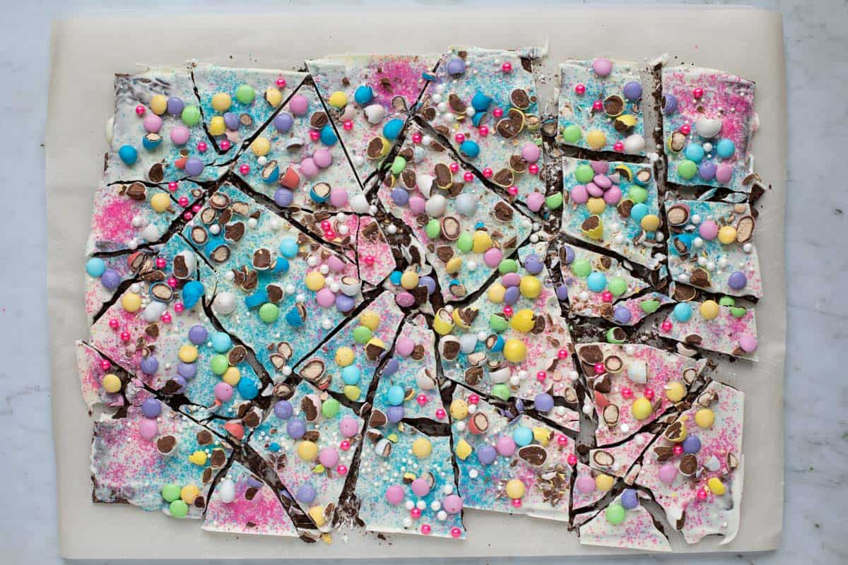 easter bark broken into several pieces on a parchment paper