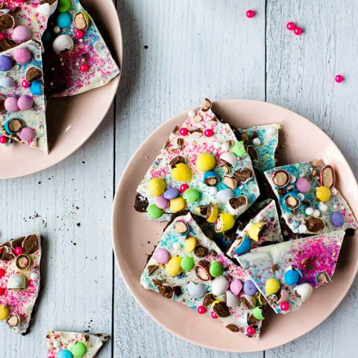 easter candy bark broken into pieced on a pink plate