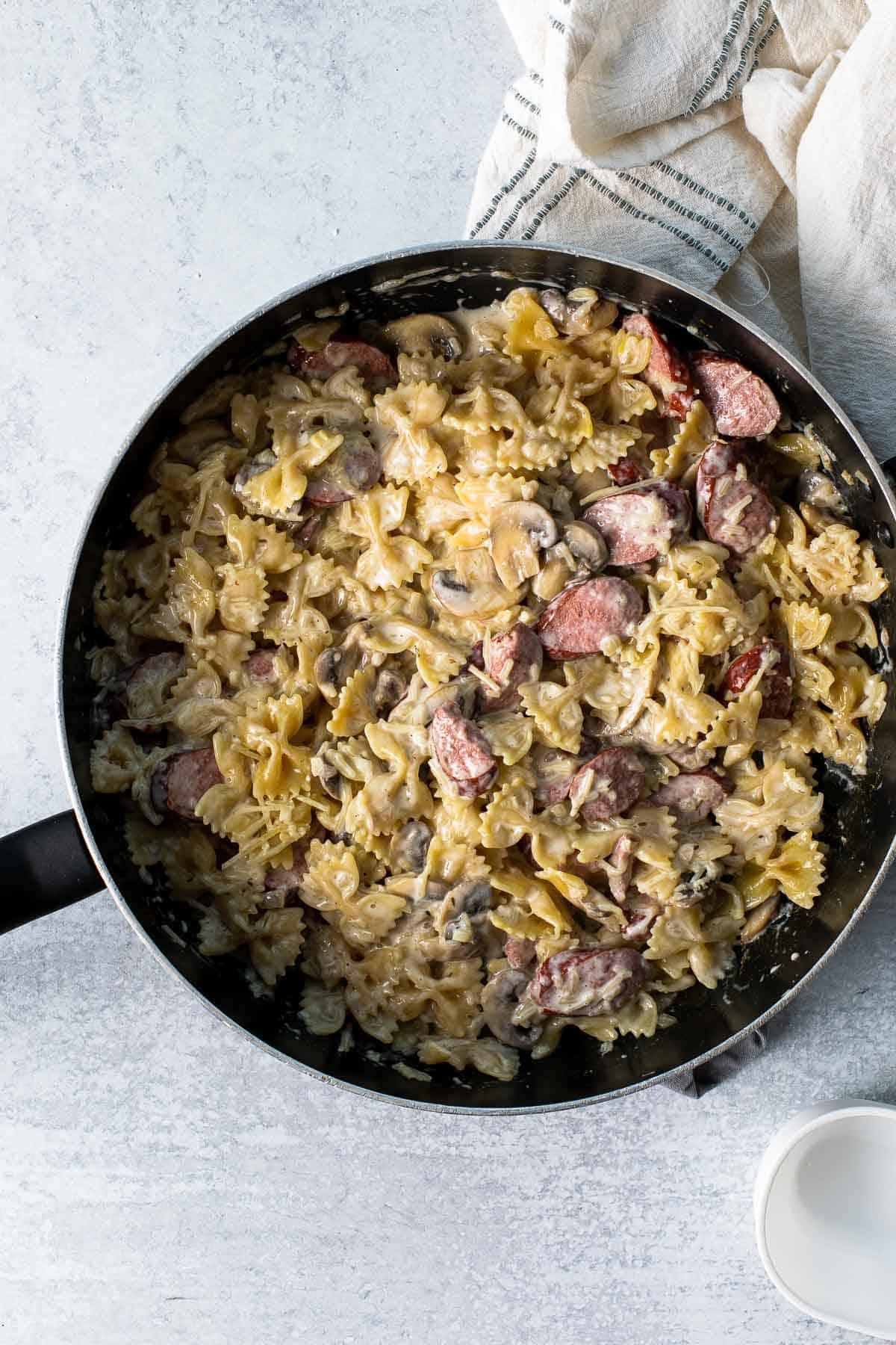 creamy sausage pasta recipe in a skillet