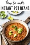 bowl of mexican beans with cilantro leaves and diced avocado