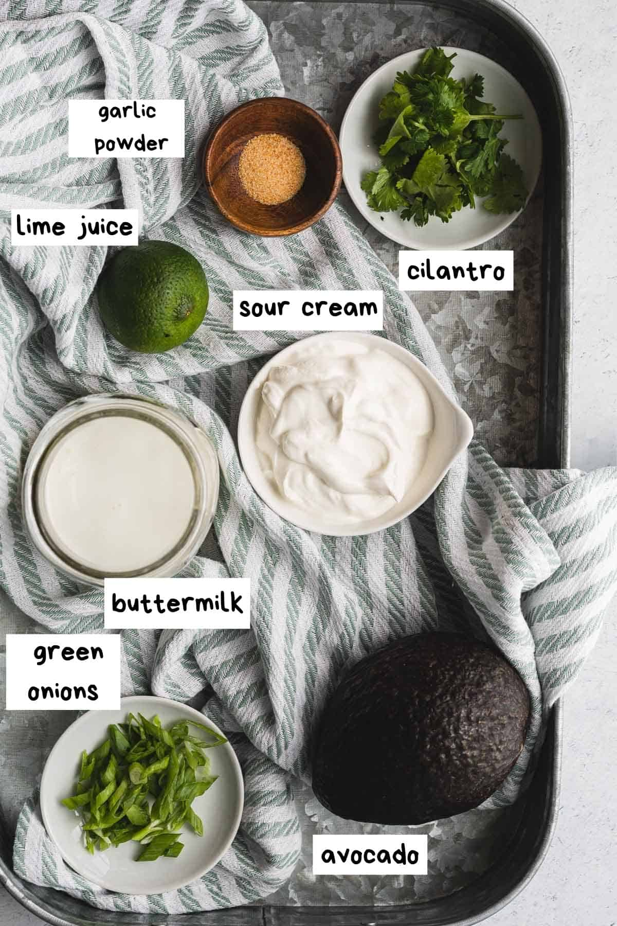 overhead view of recipe ingredients labeled on a tray with a striped towel