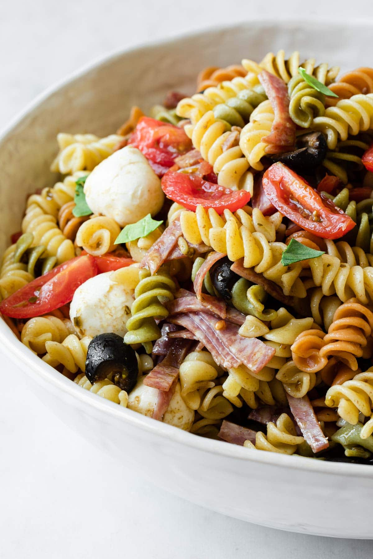 close up view to show the salad ingredients mixed with pasta