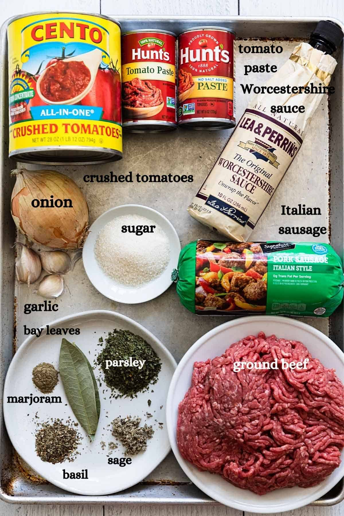 overhead view of meat sauce ingredients on a baking sheet