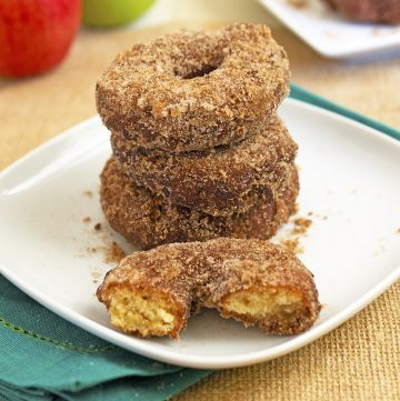 apple doughnuts stacked on on burlap cloth