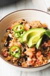 chicken burrito bowl recipe in a bowl with toppings