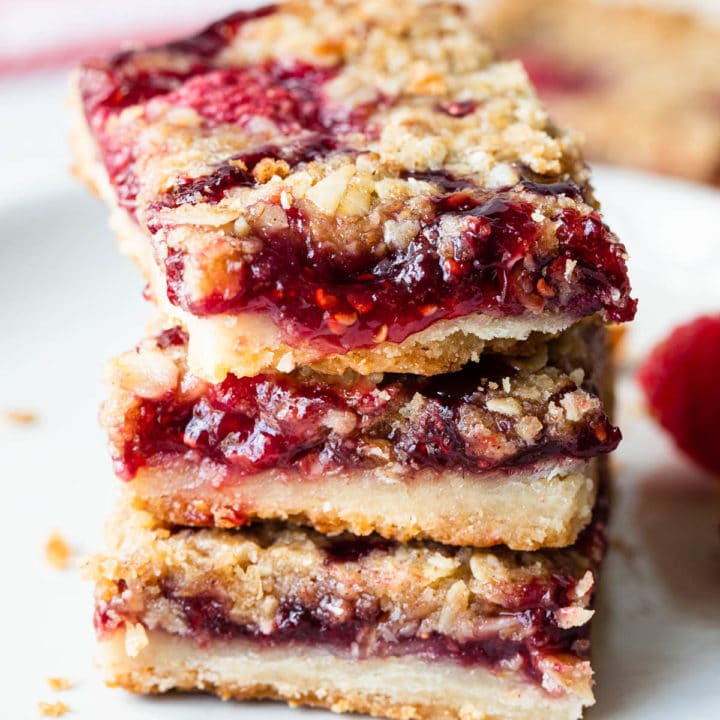 close up view of a stack of raspberry bars
