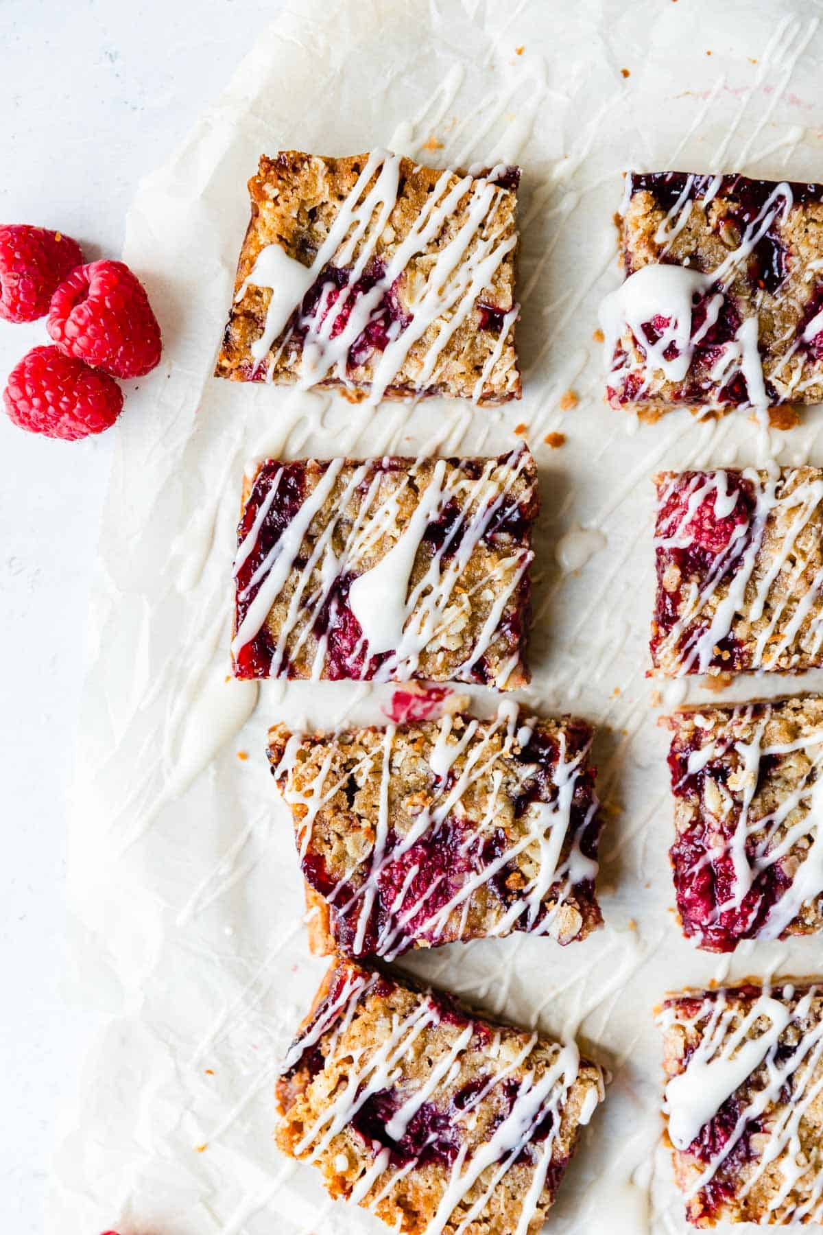 overhead view of raspberry bars drizzled with icing