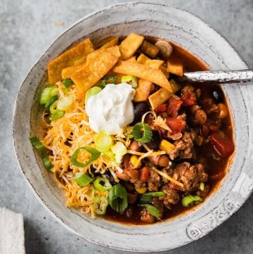 taco soup close up with toppings in a white bowl