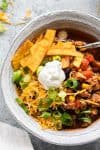 close up view of taco soup with toppings