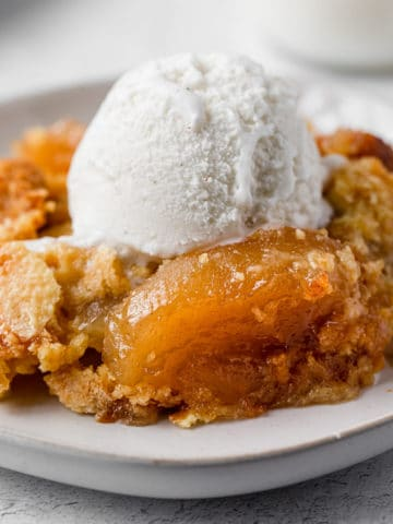 apple dump cake with a scoop of vanilla ice cream