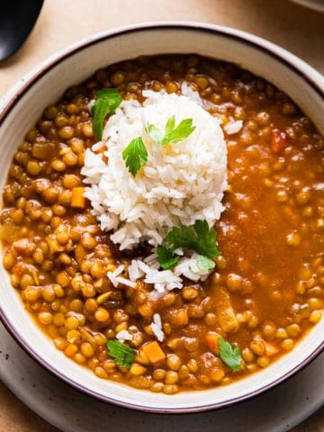 curry lentil soup topped with rice