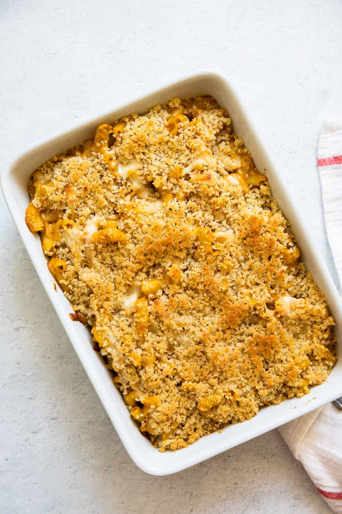 pumpkin mac and cheese baked in a casserole dish