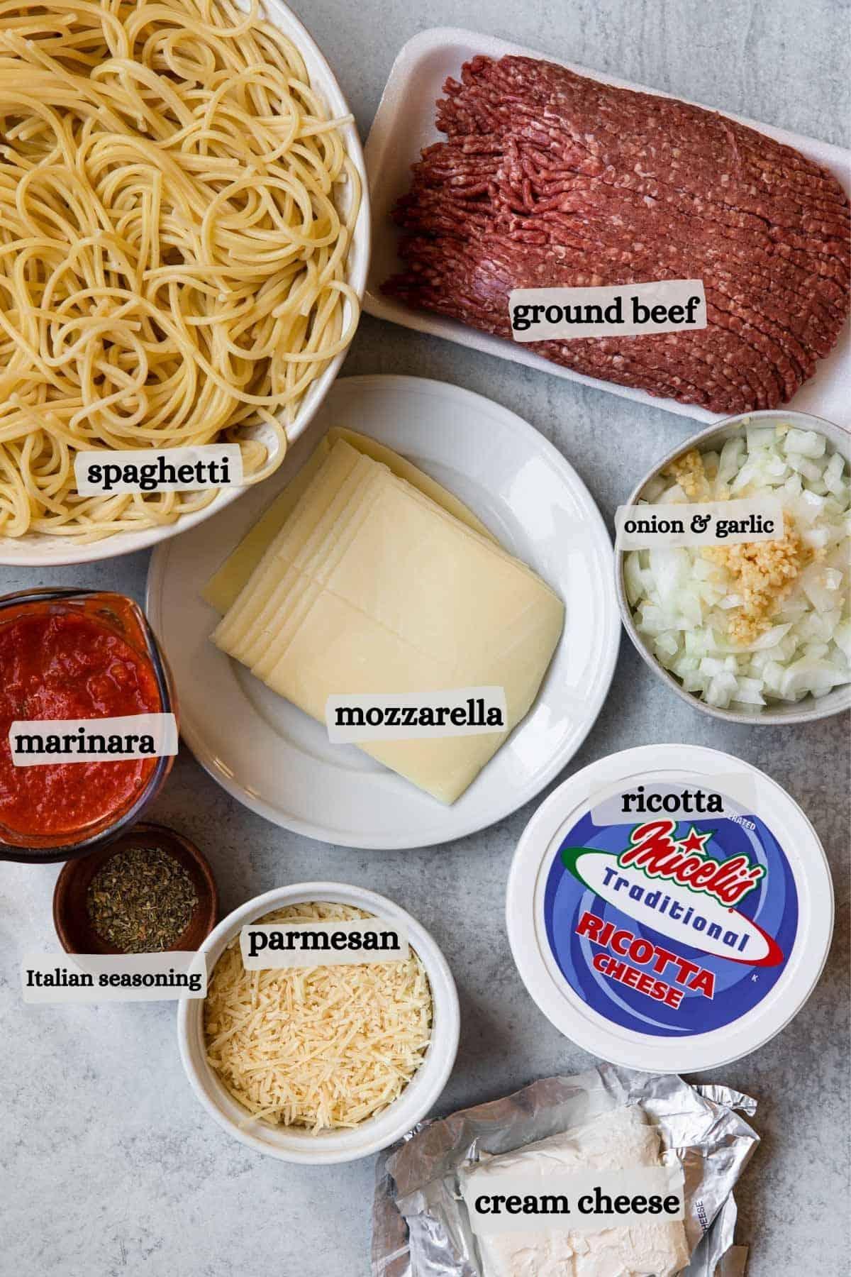 Spaghetti, ground beef, marinara, mozzarella, onion and garlic, Italian seasoning, parmesan, ricotta, creamcheese.