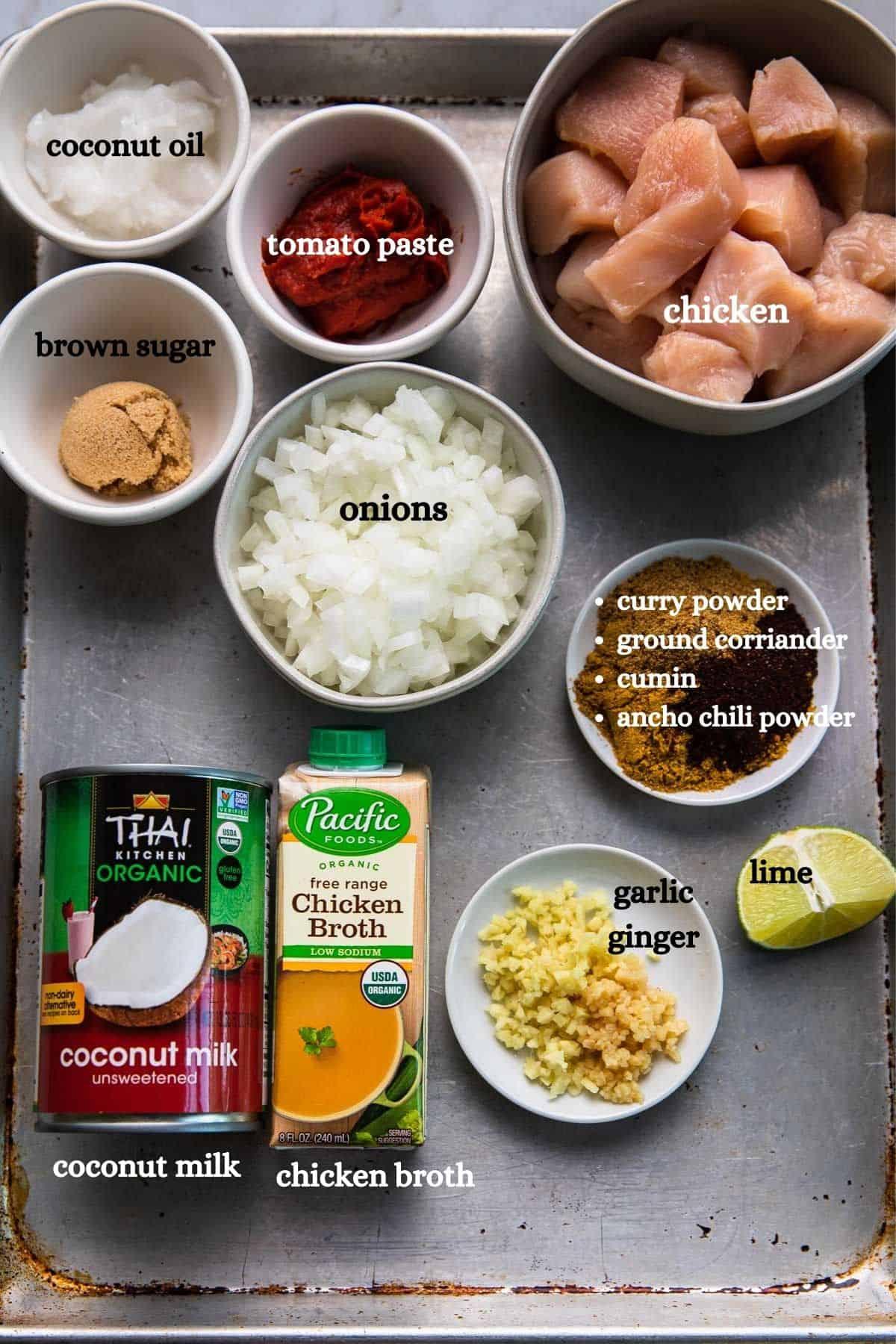 coconut oil, chicken, tomato paste, onions, spices, coconut milk, chicken broth, garlic, ginger, lime