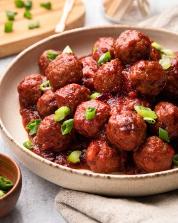 A bowl of cranberry meatballs.
