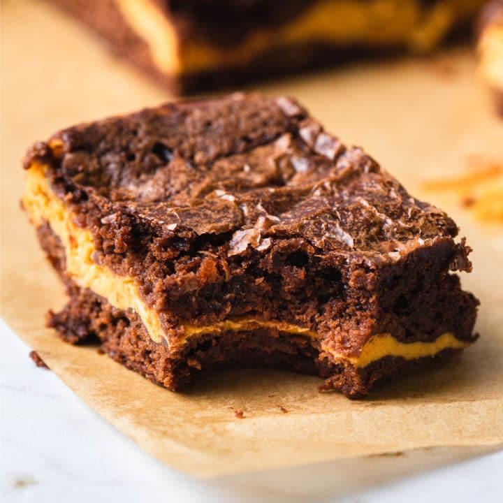 Pumpkin brownie with a bit eaten.
