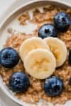 Steel cut oats with banana and blueberries.