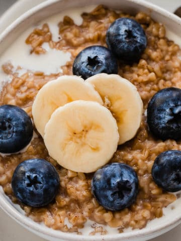 Steel cut oats with bananas and fresh blueberries.