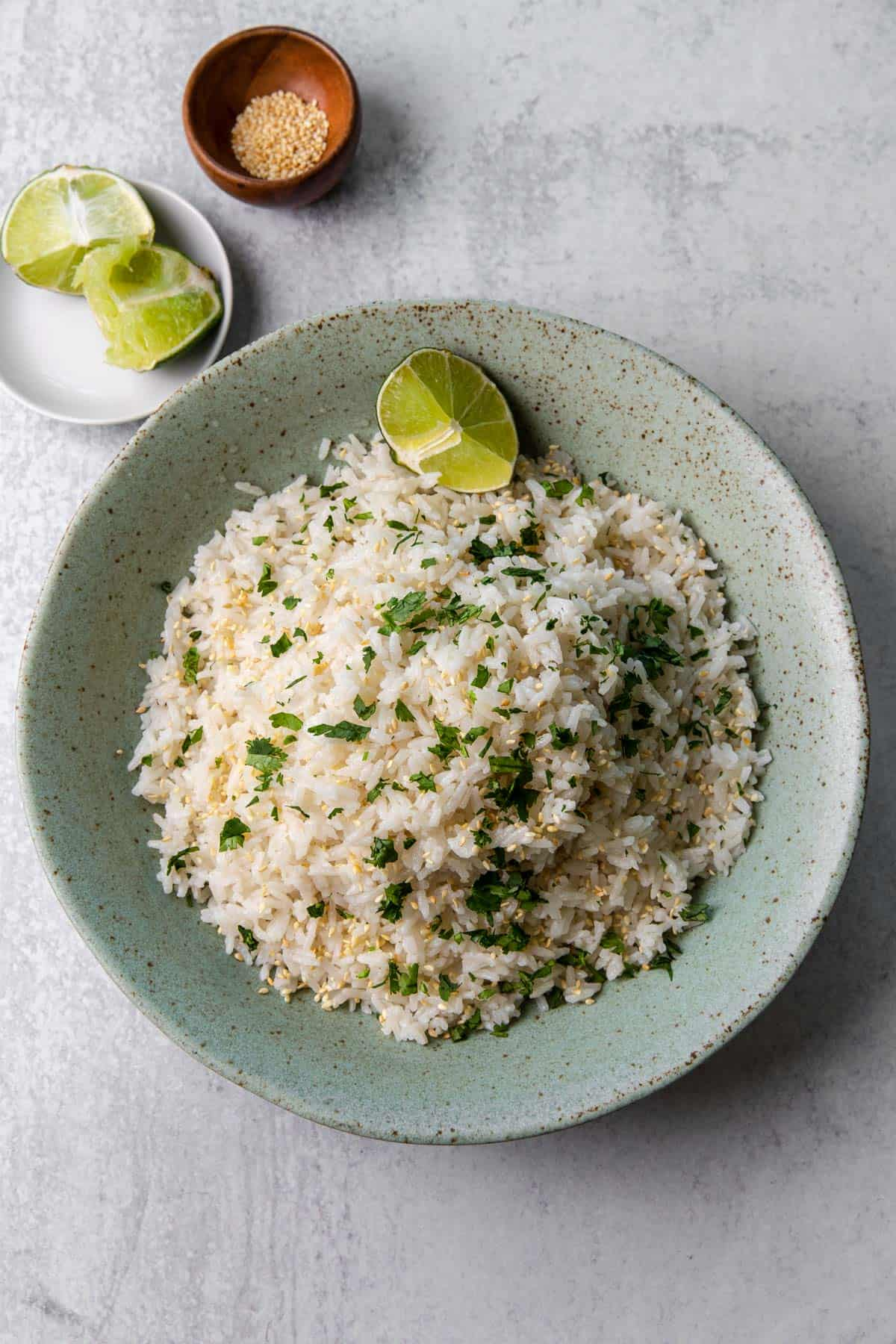 a bowl of coconut jasmine rice with lime wedge