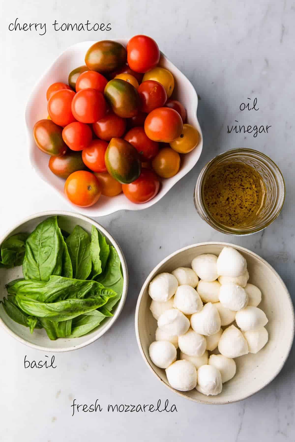 cherry tomatoes, mozzarella balls, olive oil dressing