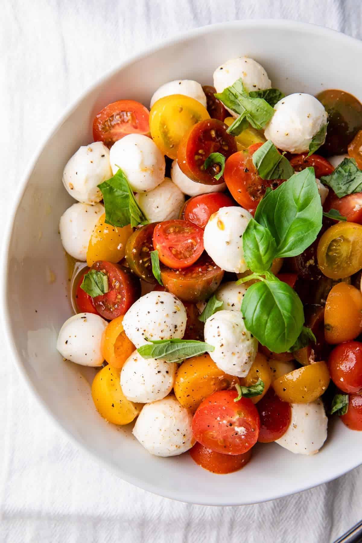 caprese salad in a white bowl