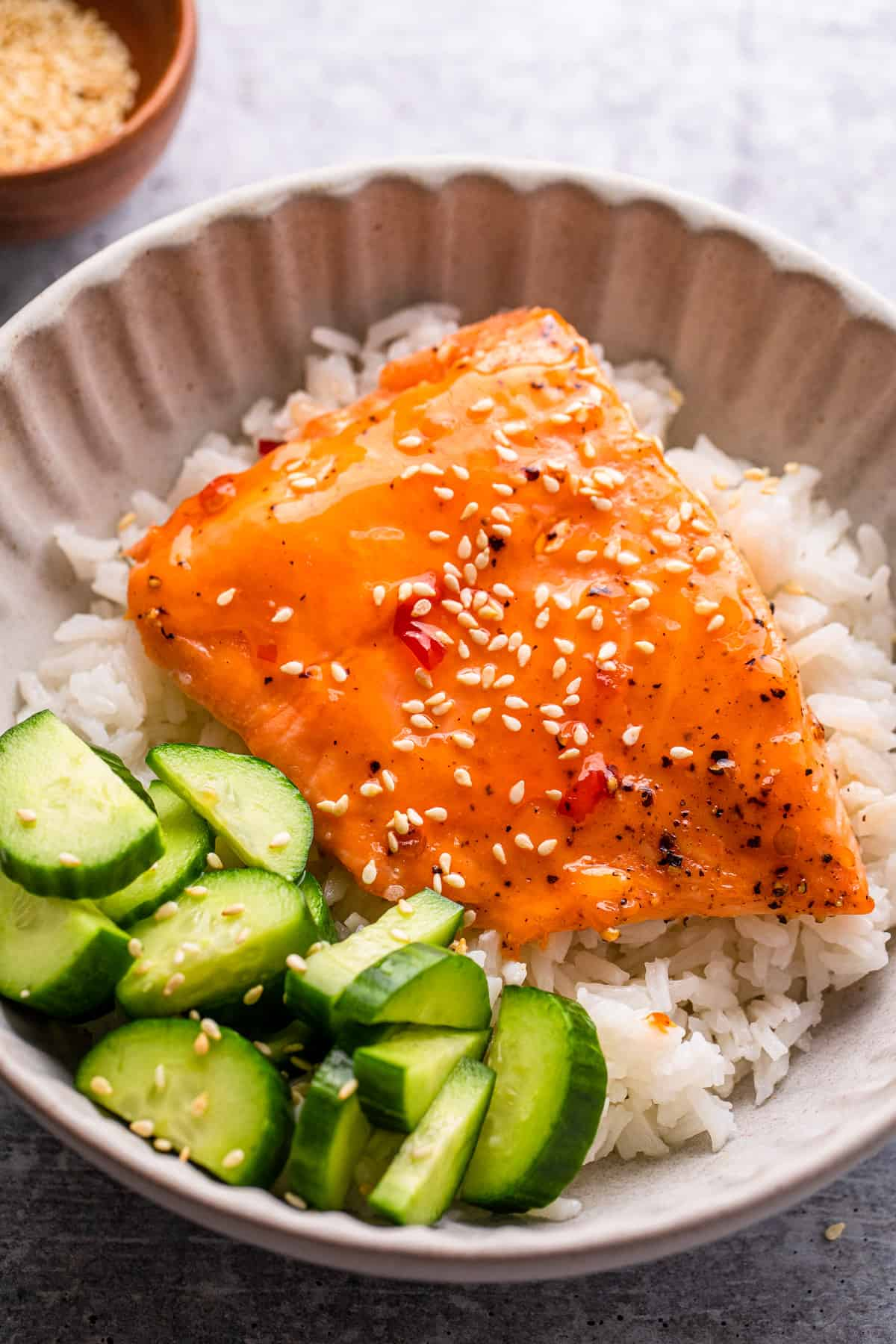 salmon over rice and cucumbers